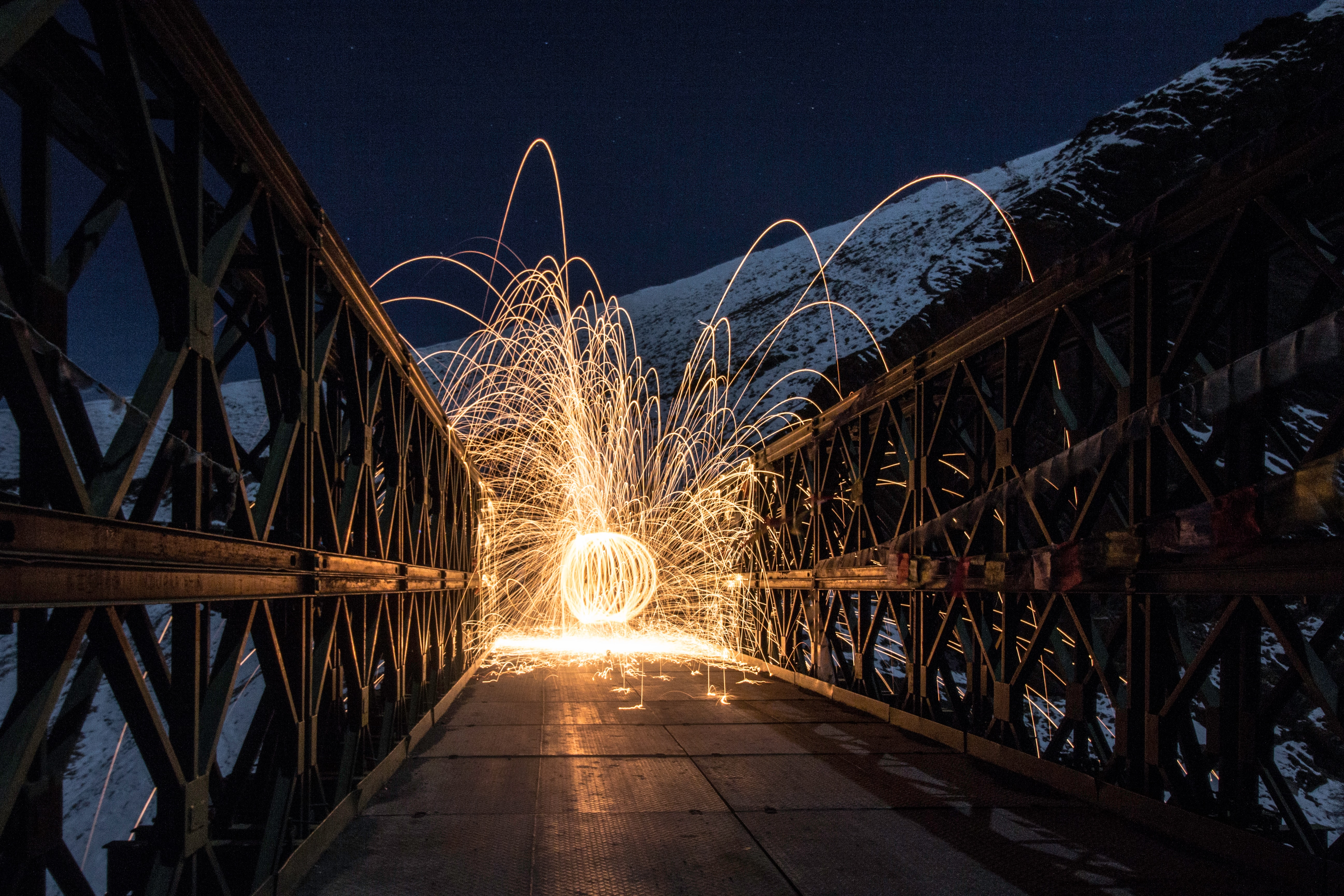 Ball spitting light on a bridge